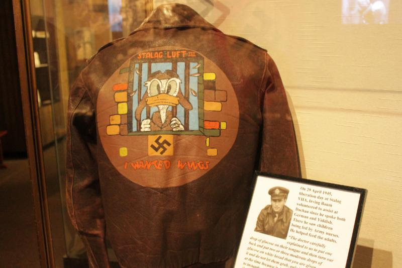 This A-2 jacket belonged to F/O Baum. The image of Donald Duck on his jacket served as the unofficial mascot for the POWs of Stalag Luft III after it was created by a fellow POW, 1st Lt. Emmet Cook of the 15th Air Force. It is currently on display at the National Museum of the Mighty Eighth Air Force.